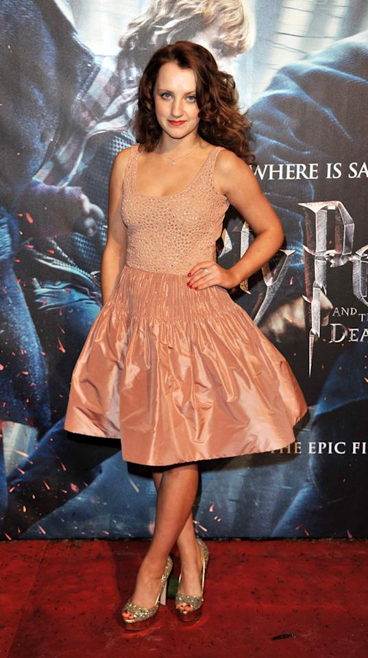 Evanna Lynch, who's earned worldwide fame thanks to her role as Harry's schoolmate Luna Lovegood, popped a pose in a peach-colored cocktail frock and sparkly heels.