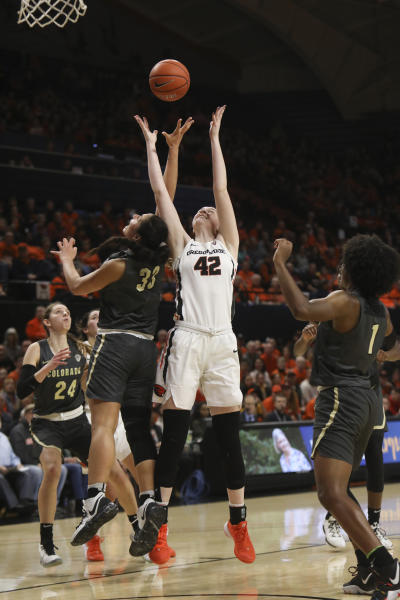 Oregon State's Kennedy Brown (42) and Colorado's Peanut Tuitele (33) fight for possession of a rebound during the first half of an NCAA college basketball game in Corvallis, Ore., Sunday, Jan. 5, 2020. (AP Photo/Amanda Loman)