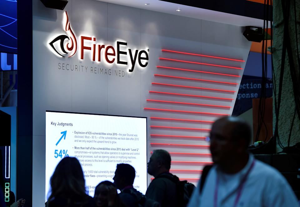 Attendees walk by the FireEye booth during the 2016 Black Hat cyber-security conference in Las Vegas, Nevada, U.S. August 3, 2016. (David Becker/Reuters)