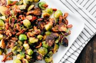 """Chopped dates melt into a sweet and sticky glaze to counter the salty bacon in this easy side dish. <a href=""""https://www.epicurious.com/recipes/food/views/3-ingredient-sweet-and-smoky-brussels-sprouts?mbid=synd_yahoo_rss"""" rel=""""nofollow noopener"""" target=""""_blank"""" data-ylk=""""slk:See recipe."""" class=""""link rapid-noclick-resp"""">See recipe.</a>"""