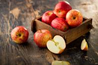 """<p>An apple a day can keep the doctor away , but how do you keep brown spots away from your apple? There are a <a href=""""https://www.thedailymeal.com/eat/apple-varieties-uses?referrer=yahoo&category=beauty_food&include_utm=1&utm_medium=referral&utm_source=yahoo&utm_campaign=feed"""" rel=""""nofollow noopener"""" target=""""_blank"""" data-ylk=""""slk:wide variety of apples"""" class=""""link rapid-noclick-resp"""">wide variety of apples</a>, which are all fine to be kept on the counter, though they'll ripen and go mushy much faster. If you want your apple to stay crisp and crunchy for longer, place your apples in the fridge. Be careful what produce you store near them, though — apples release ethylene gas as they ripen, which can quicken the ripening of other fruits, including oranges, bananas and peaches.</p>"""
