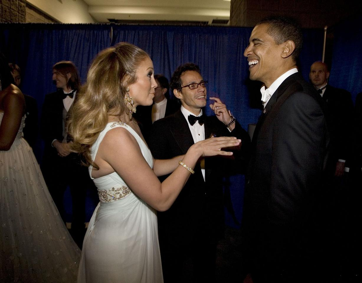 <p>J.Lo cracks up the president backstage at the inaugural ball, where she and then-husband Marc Anthony performed in 2009. </p>