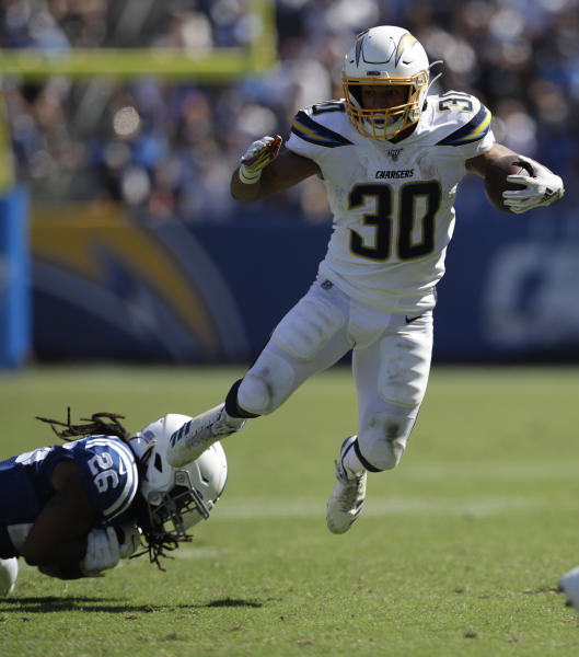 Los Angeles Chargers running back Austin Ekeler, right, breast away form Indianapolis Colts strong safety Clayton Geathers during the second half in an NFL football game Sunday, Sept. 8, 2019, in Carson, Calif. (AP Photo/Marcio Jose Sanchez)