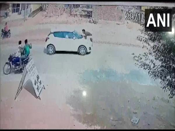 A constable was dragged on the bonnet by a car driver in Aligarh.