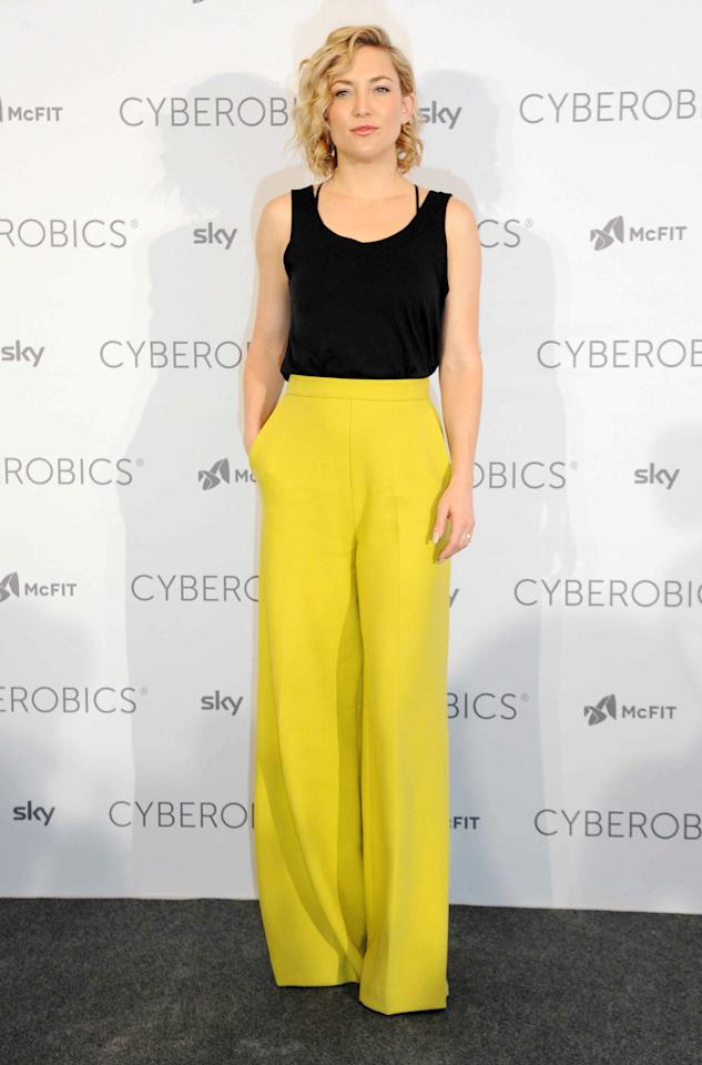 <p>It takes guts to don a pair of trousers this eye-catching, but teamed with a plain black tank top, Hudson showed how it's done. <i>[Photo: Rex]</i></p>