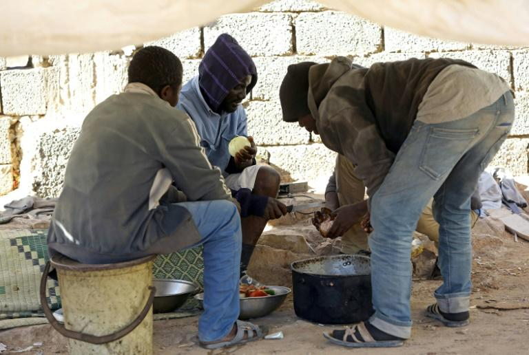 African migrants prepare food at the Safe House in the town of Bani Walid, on the edge of the desert southeast of the Libyan capital Tripoli