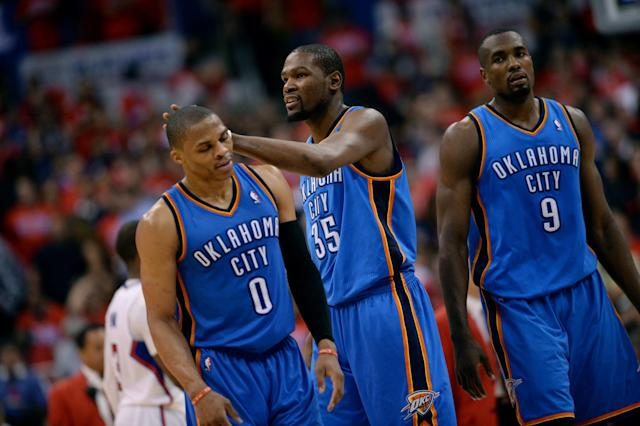LOS ANGELES, CA - MAY 9: Russell Westbrook #0, Kevin Durant #35, and Serge Ibaka #9 of the Oklahoma City Thunder celebrate during a game against the Los Angeles Clippers in Game Three of the Western Conference Semifinals during the 2014 NBA Playoffs at Staples Center on May 9, 2014 in Los Angeles, California. (Photo by Noah Graham/NBAE via Getty Images)