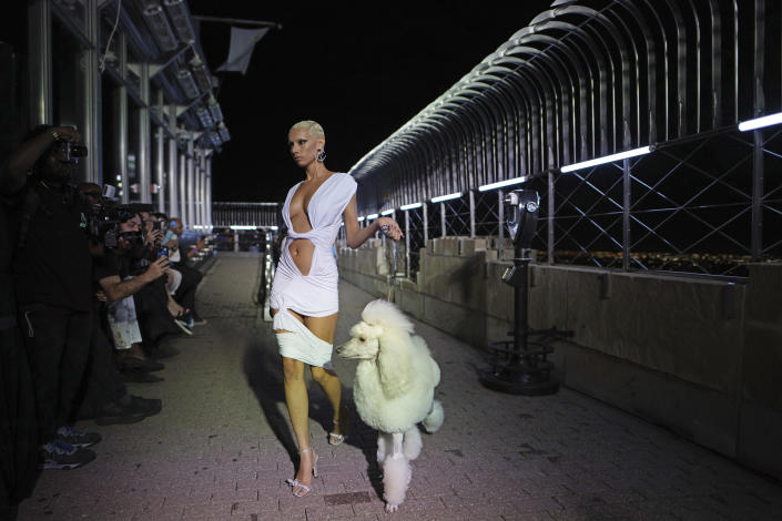 The LaQuan Smith collection is modeled at the Empire State Building during New York Fashion Week on Thursday, Sept. 9, 2021, in New York. (Photo by Charles Sykes/Invision/AP)