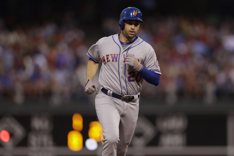 Neil Walker is back in the playoff race after being traded to the Milwaukee Brewers. (AP)