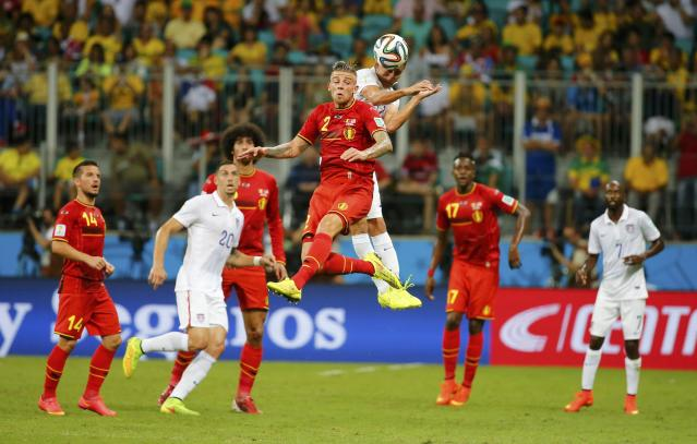 Belgium's Toby Alderweireld jumps for the ball with Alejandro Bedoya of the U.S. during their 2014 World Cup round of 16 game at the Fonte Nova arena in Salvador July 1, 2014. REUTERS/Yves Herman (BRAZIL - Tags: SOCCER SPORT WORLD CUP)