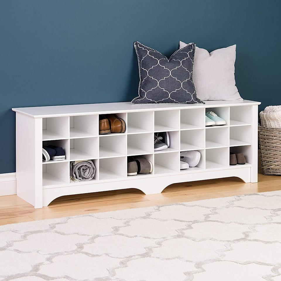 "<p>Organize your entry way with this <a href=""https://www.popsugar.com/buy/Prepac%2024%20Pair%20Shoe%20Storage%20Cubby%20Bench-460908?p_name=Prepac%2024%20Pair%20Shoe%20Storage%20Cubby%20Bench&retailer=amazon.com&price=137&evar1=casa%3Aus&evar9=46286173&evar98=https%3A%2F%2Fwww.popsugar.com%2Fhome%2Fphoto-gallery%2F46286173%2Fimage%2F46286409%2FPrepac-24-Pair-Shoe-Storage-Cubby-Bench&prop13=mobile&pdata=1"" rel=""nofollow"" data-shoppable-link=""1"" target=""_blank"">Prepac 24 Pair Shoe Storage Cubby Bench</a> ($137).</p>"