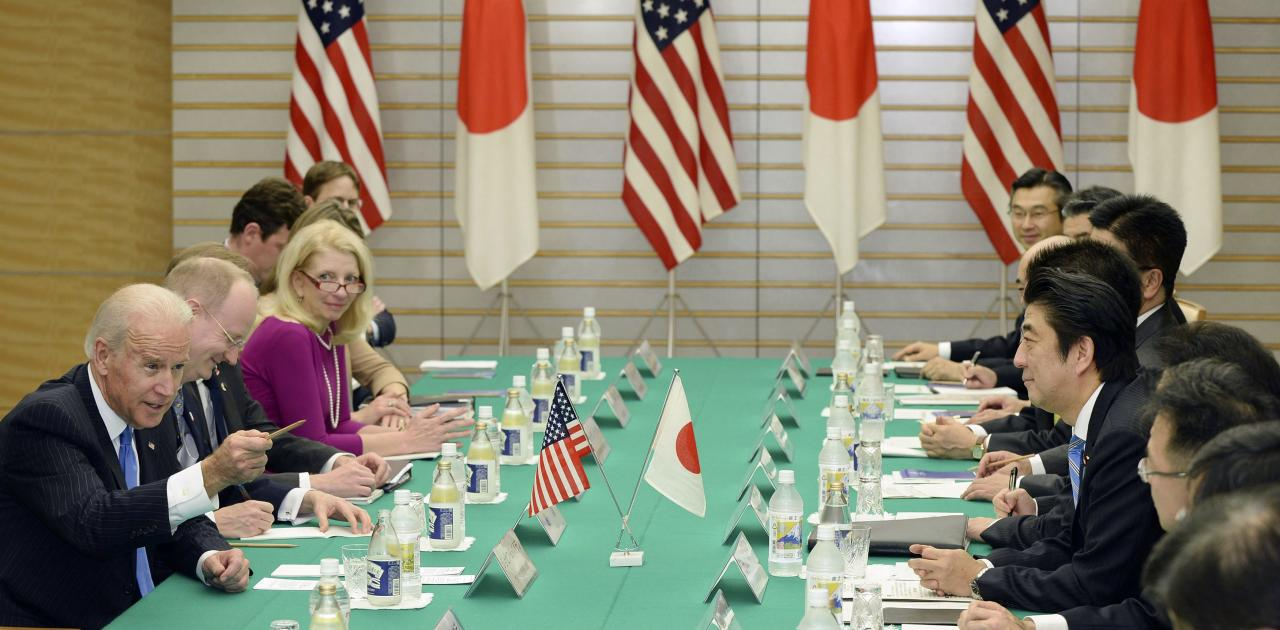 U.S. Vice President Joe Biden (L) talks with Japanese Prime Minister Shinzo Abe (4th R) during their meeting at Abe's official residence in Tokyo December 3, 2013. Biden urged Japan and China to lower tensions that have spiked since Beijing announced an air defense zone over disputed islands in the East China Sea, while repeating that Washington was worried by the move. REUTERS/Toru Yamanaka/Pool (JAPAN - Tags: POLITICS)