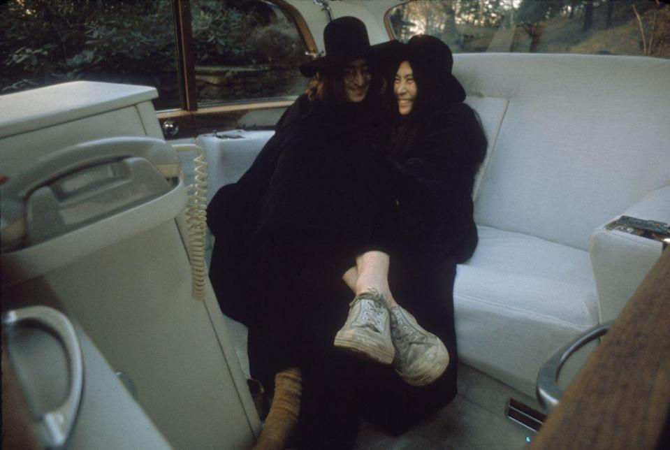 <p>John Lennon and Yoko Ono clown around in the back seat of an all-white white luxury car, December 1968.</p>