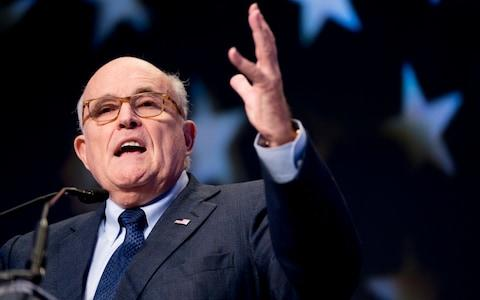 Rudy Giuliani has continued to make public allegations about Joe Biden's behaviour in Ukraine since the impeachment inquiry was launched - Credit: Andrew Harnik/AP