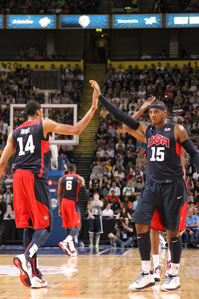 MANCHESTER, UK - JULY 19: Carmelo Anthony #15 and Anthony Davis #14 of the 2012 US Men's Senior National Team high five each other during an exhibition game against Great Britain's Men's team at the Manchester Arena on July 19, 2012 in Manchester, UK. NOTE TO USER: User expressly acknowledges and agrees that, by downloading and or using this photograph, User is consenting to the terms and conditions of the Getty Images License Agreement. Mandatory Copyright Notice: Copyright 2012 NBAE (Photo by Nathaniel S. Butler/NBAE via Getty Images)