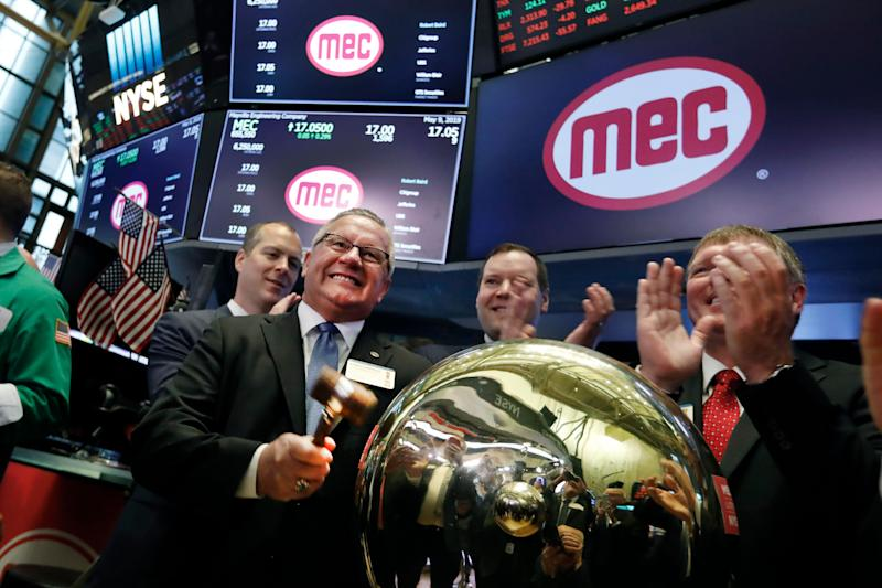 Mayville Engineering Chairman, President & CEO Robert Kamphuis, left, rings a ceremonial bell on the floor of the New York Stock Exchange, as his company's IPO begins trading, Thursday, May 9, 2019. (AP Photo/Richard Drew)