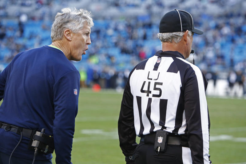 File-This Dec. 15, 2019, file photo shows Seattle Seahawks head coach Pete Carroll yelling at an official during the second half of an NFL football game against the Carolina Panthers in Charlotte, N.C. No matter how many spectacular plays Lamar Jackson and Russell Wilson made, officiating overshadowed the NFL this season. (AP Photo/Brian Blanco, File)