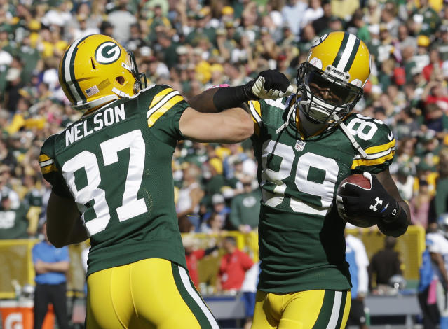 Green Bay Packers' James Jones is congratulated by Jordy Nelson (87) after Jones caught an 83-yard touchdown pass during the second half of an NFL football game against the Detroit Lions Sunday, Oct. 6, 2013, in Green Bay, Wis. (AP Photo/Morry Gash)