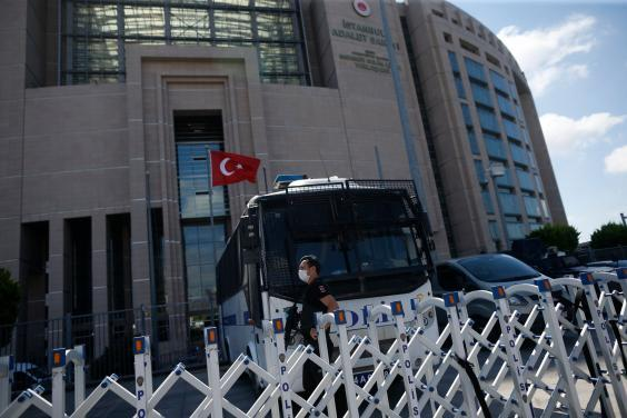 A police officer guards one of the entrances to the court in Istanbul (AP)