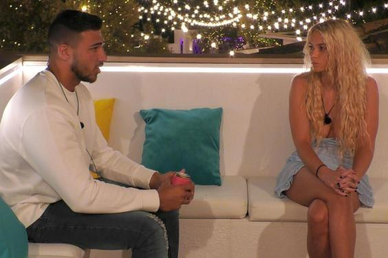 Lucie Donlan and Tommy Fury chat on the third episode of Love Island. (Photo by ITV/REX)