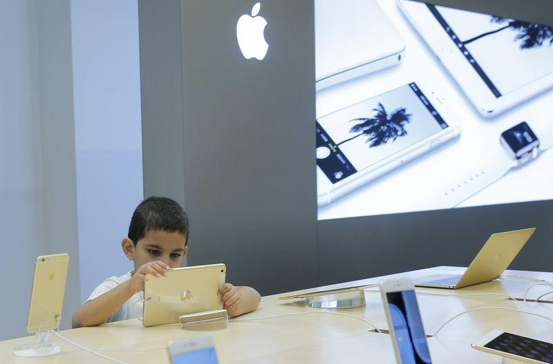 A boy views an iPad at an Apple shop in the Central Universal Department Store (TsUm) in Moscow