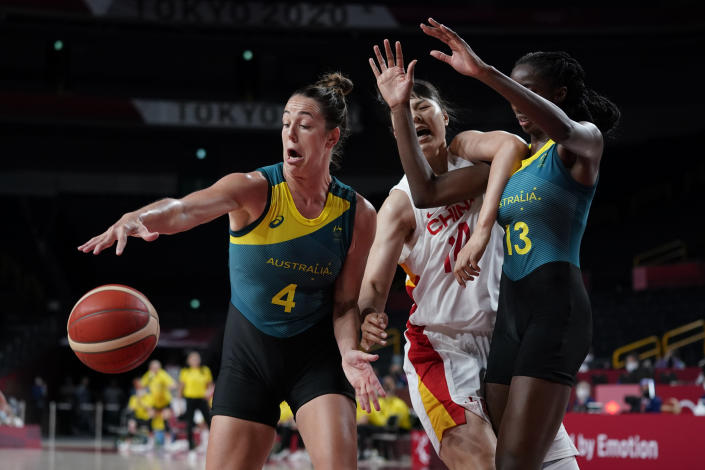 Australia's Jenna O'Hea (4) and Ezi Magbegor (13) battle with China's Yueru Li (14) for loose ball during a women's basketball preliminary round game at the 2020 Summer Olympics in Saitama, Japan, Friday, July 30, 2021. (AP Photo/Charlie Neibergall)