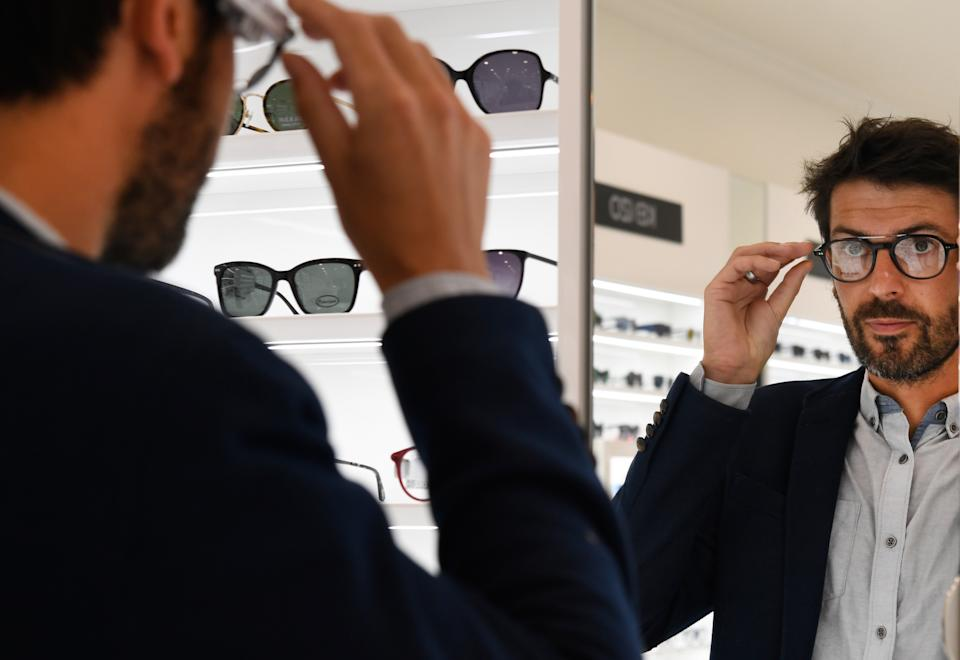 A man tries glasses on July 2, 2018 (Photo by Fred TANNEAU / AFP)        (Photo credit should read FRED TANNEAU/AFP via Getty Images)