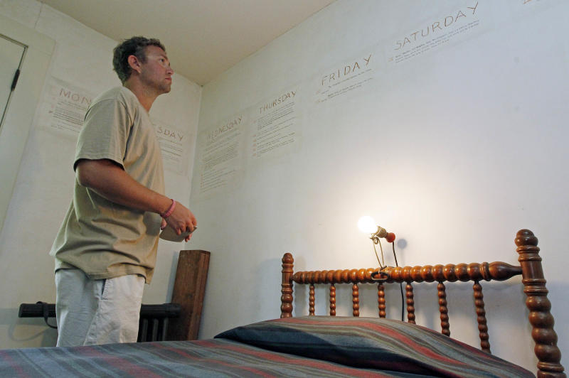 "In this June 8, 2012 photograph, Ryan Spilker, a student at the University of Mississippi, studies the late Nobel Prize laureate William Faulkner's handwriting on the walls of his downstairs office at his antebellum home, Rowan Oak, now a museum owned by the University of Mississippi, in Oxford, Miss. Using pencil, Faulkner outlined events of ""A Fable,"" a 1954 novel that unfolds during Holy Week and was one of his few books not set in fictional Yoknapatawpha County. Oxford commemorates the 50th anniversary of the Nobel laureate's death July 6 with several events, including a tag-team reading of one of his novels, ""The Reivers,"" beginning about daybreak. (AP Photo/Rogelio V. Solis)"