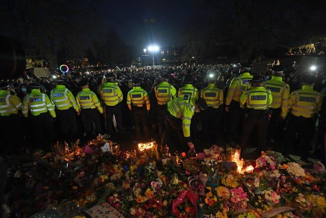 Police surround the band stand in Clapham Common, London, after the Reclaim These Streets vigil for Sarah Everard was officially cancelled