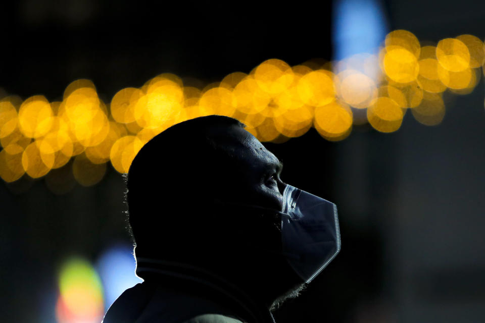 In this photo taken on Saturday, Dec. 26, 2020 a man wearing a mask against the coronavirus, looks at a screen before the arrival of the first batch of COVID-19 vaccines at the National Center for Storage of the COVID-19 Vaccine, a military run facility, in Bucharest, Romania. Across the Balkans and the rest of the nations in the southeastern corner of Europe, a vaccination campaign against the coronavirus is overshadowed by heated political debates or conspiracy theories that threaten to thwart the process. In countries like the Czech Republic, Serbia, Bosnia, Romania and Bulgaria, skeptics have ranged from former presidents to top athletes and doctors. Nations that once routinely went through mass inoculations under Communist leaders are deeply split over whether to take the vaccines at all. (AP Photo/Vadim Ghirda)