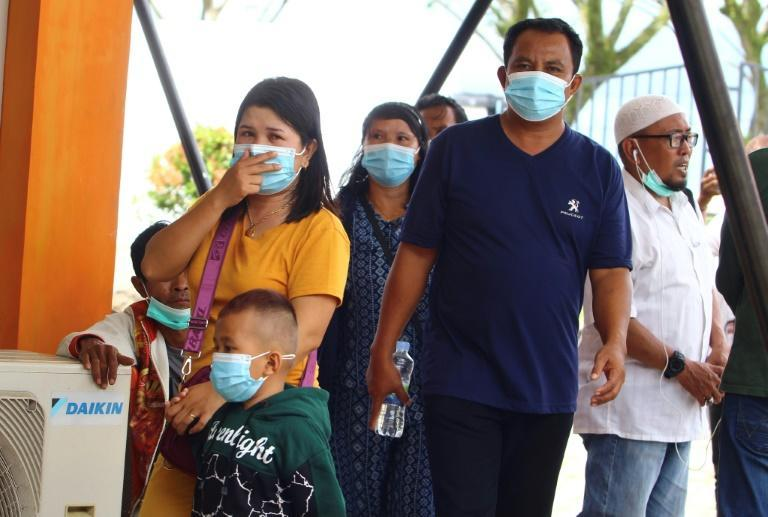 Family members gather at the airport in Pontianak