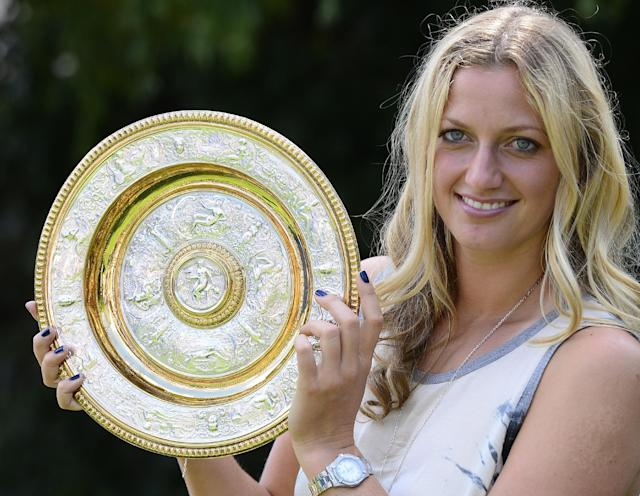 Czech tennis player Petra Kvitova holds the trophy of the All England Lawn Tennis Championships in Wimbledon at the press conference in Prague, Monday, July 7, 2014. She won the women's singles final against Eugenie Bouchard of Canada. (AP Photo,CTK/Roman Vondrous)