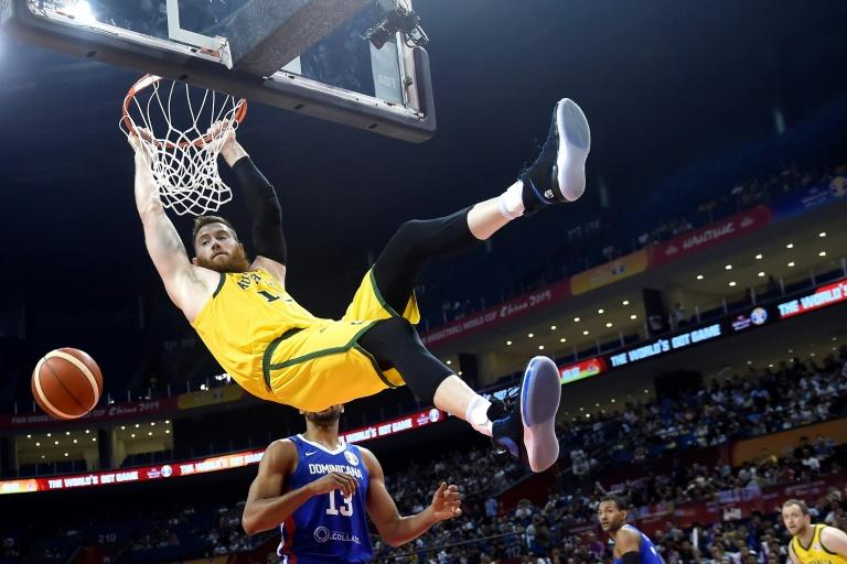 Andrew Bogut was booed by Chinese fans during Australia's victory over the Dominican Republic after his barbed comment about national swimming hero Sun Yang