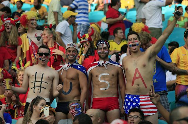 US supporters cheer ahead of their World Cup match against Belgium at The Fonte Nova Arena in Salvador on July 1, 2014 (AFP Photo/Adrian Dennis)