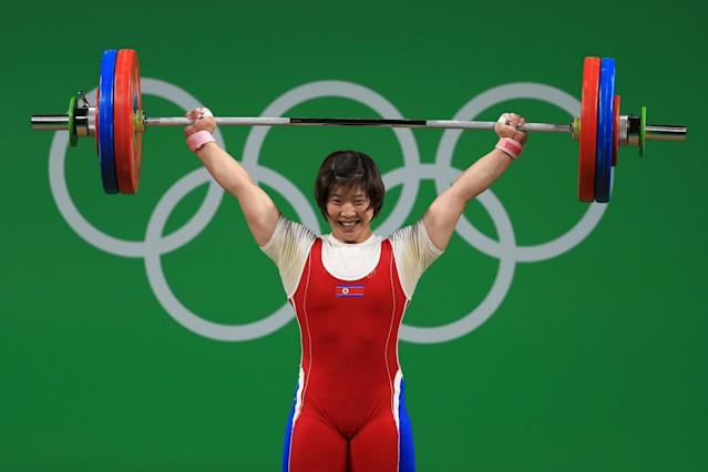 <p>Jong Sim Rim of North Korea in action during the Weightlifting – Women's 75kg Group A on Day 7 of the Rio 2016 Olympic Games at Riocentro – Pavilion 2 on August 12, 2016 in Rio de Janeiro, Brazil. (Getty) </p>