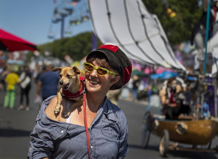 Lili Noden and her dog, Tica, creator of the Dragon Knights Stilt Theater.