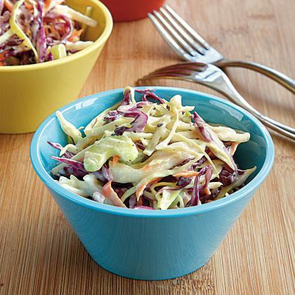 """<p>With a combination of red and green cabbage, this yummy <a href=""""https://www.myrecipes.com/t/salads/coleslaw"""" rel=""""nofollow noopener"""" target=""""_blank"""" data-ylk=""""slk:coleslaw"""" class=""""link rapid-noclick-resp"""">coleslaw</a> dish will win anyone over! Serve with your favorite barbecue or taco meals.</p>"""
