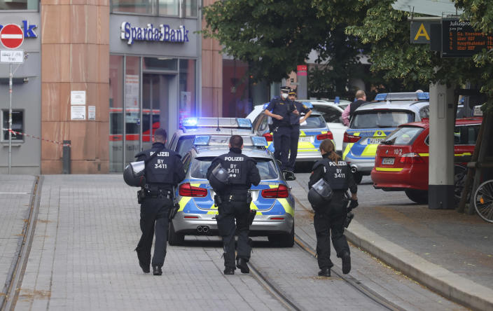 Police cars attend the scene of an incident in Wuerzburg, Germany, Friday June 25, 2021. German police say several people have been killed and others injured in a knife attack in the southern city of Wuerzburg on Friday. (Karl-Josef Hildenbrand/dpa via AP)
