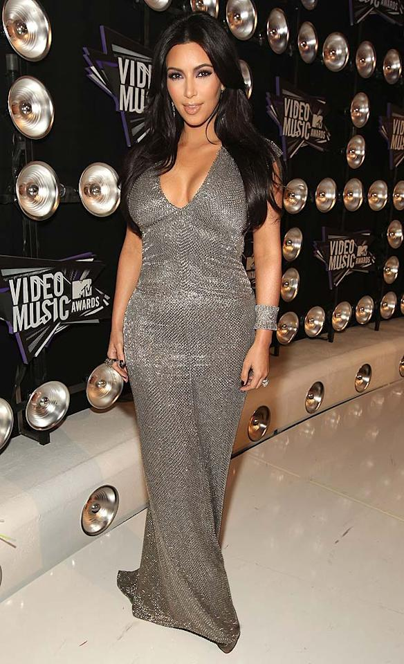 """Newlywed Kim Kardashian -- who rushed back from her honeymoon in Italy to attend the MTV event -- donned a silver Kaufmanfranco frock that accentuated her voluptuous physique. Christopher Polk/a href=""""http://www.gettyimages.com/"""" target=""""new"""">GettyImages.com - August 28, 2011"""