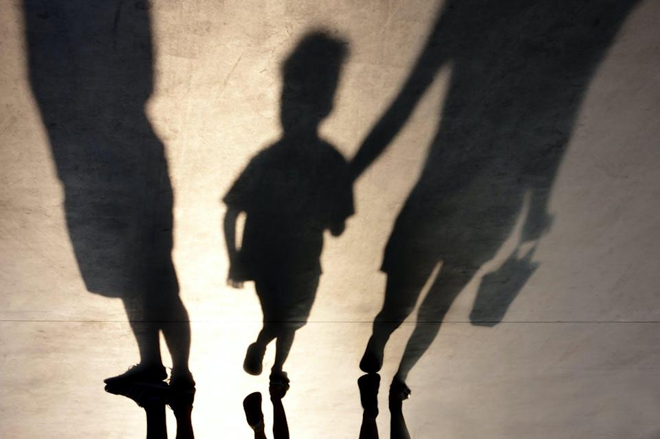 "<span class=""attribution""><a class=""link rapid-noclick-resp"" href=""https://www.shutterstock.com/es/image-photo/blurry-shadows-mother-walking-son-hand-730170508"" rel=""nofollow noopener"" target=""_blank"" data-ylk=""slk:Shutterstock / Alex Linch"">Shutterstock / Alex Linch</a></span>"
