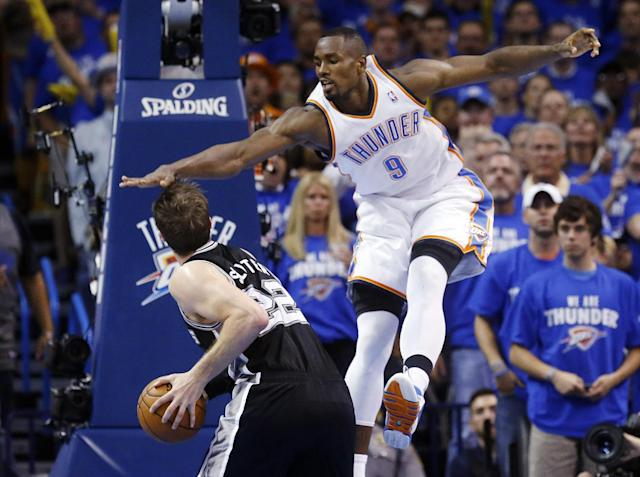 Oklahoma City Thunder forward Serge Ibaka (9) gets up to block a shot by San Antonio Spurs center Tiago Splitter (22) in the second quarter of Game 4 of the Western Conference finals NBA basketball playoff series in Oklahoma City, Tuesday, May 27, 2014. (AP Photo/Sue Ogrocki)