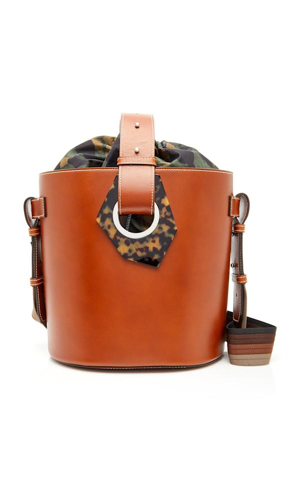 <p>The trendy silhouette will bring even your most casual outfits to life. This one gets bonus points for the geometric tortoiseshell panels and the removable drawstring pouch.</p>