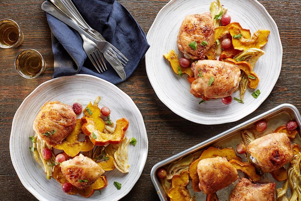 """Juices from cumin-rubbed chicken thighs season sweet roasted grapes, fennel, and squash in this simple yet flavorful one-pan dinner. Fresh mint adds an intriguing finishing touch. <a href=""""https://www.epicurious.com/recipes/food/views/sheet-pan-cumin-chicken-thighs-with-squash-fennel-and-grapes-56390000?mbid=synd_yahoo_rss"""" rel=""""nofollow noopener"""" target=""""_blank"""" data-ylk=""""slk:See recipe."""" class=""""link rapid-noclick-resp"""">See recipe.</a>"""