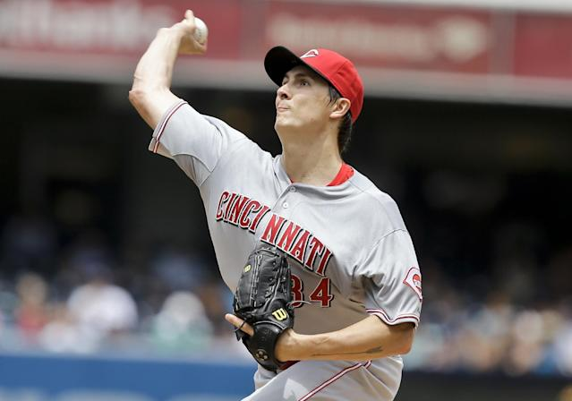 Cincinnati Reds starter Homer Bailey works against the San Diego Padres in the first inning of a baseball game in San Diego, Wednesday, July 31, 2013. (AP Photo/Lenny Ignelzi)