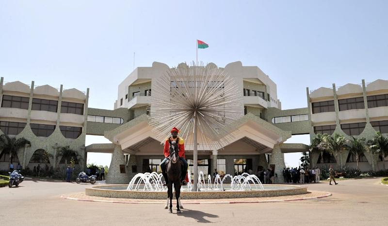 A guard sits on his horse outside the Presidential Palace in the Ouaga 2000 distrit of the capital Ouagadougou on November 7, 2013 (AFP Photo/Issouf Sanogo)