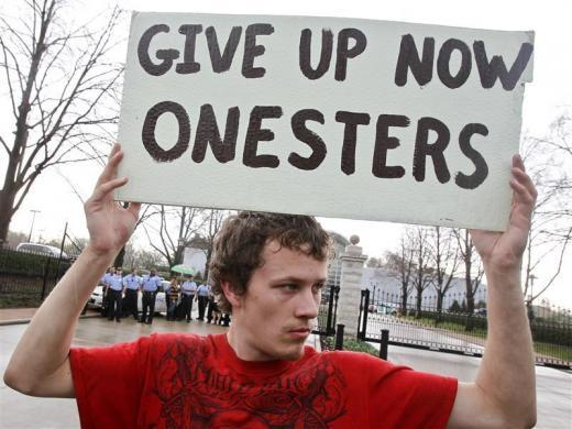 "Jacob Knowles of Occupy Columbia joins other movements across the Midwest to protest against Monsanto's agricultural practices in front of the Missouri Botanical Garden during the ""Occupy the Midwest"" regional conference in St. Louis, Missouri March 16, 2012."