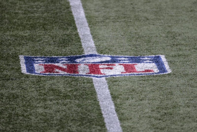 NFL logo on the field during a game.