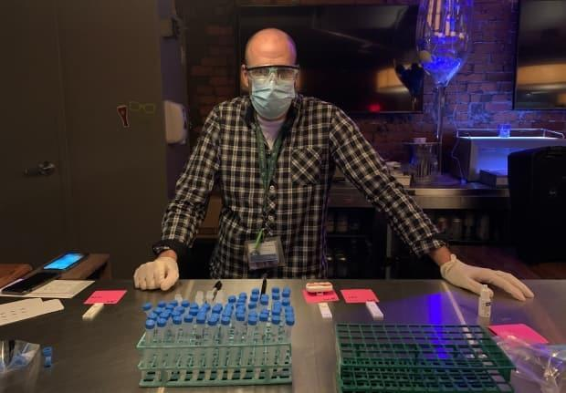 Dr. Todd Hatchette is shown at the first rapid testing site in Nova Scotia last November. It was held at a vacant nightclub in Halifax.