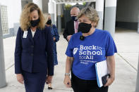 American Federation of Teachers President Randi Weingarten, right, speaks with Broward County Schools interim superintendent Vickie Cartwright, left, while visiting the New River Middle School, Thursday, Sept. 2, 2021, in Fort Lauderdale, Fla. Weingarten is on a nationwide tour of schools to stress the importance of safely returning to five-day-a-week in person learning. Broward County is one of numerous school districts in Florida with a mask mandate for students. (AP Photo/Lynne Sladky)