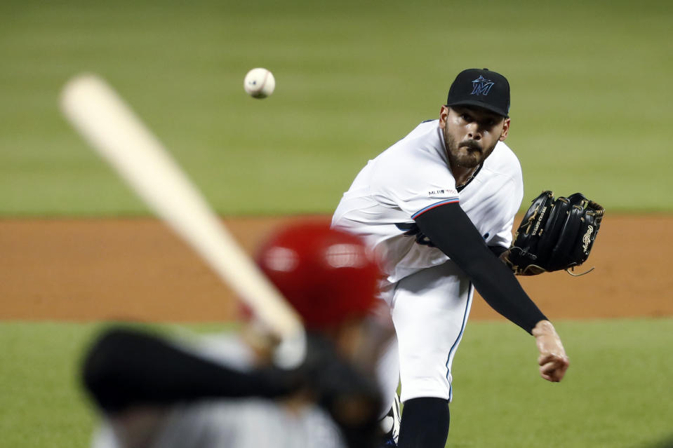 Miami Marlins' Pablo Lopez, top, pitches to Cincinnati Reds' Eugenio Suarez during the first inning of a baseball game Monday, Aug. 26, 2019, in Miami. (AP Photo/Wilfredo Lee)